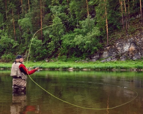 fly-fishing-angler-makes-cast-while-standing-water_168410-313.jpg